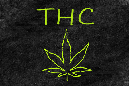 Cannabis storefront blackboard drawing of marijuana leaf with chalk on chalkboard billboard texture - Store selling THC. THC is the main psychoactive compound in marijuana. Stock Photo