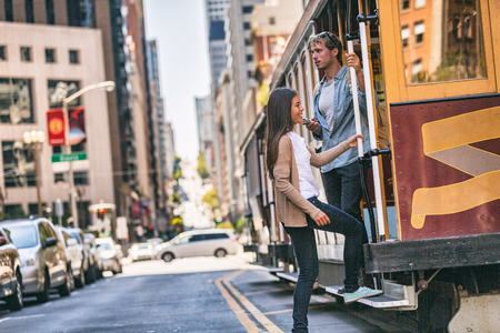 San Francisco cable car tram people tourists taking the popular tourist attraction tramway of the Powel-Hyde California, USA travel. Stockfoto