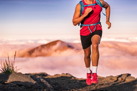 Man athlete trail running in the mountains landscape. Runner athlete training.