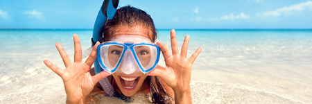 Snorkel watersport girl fun - Happy Asian tourist woman screaming of joy enjoying swimming with scuba mask on summer Caribbean travel vacation holidays banner panorama.
