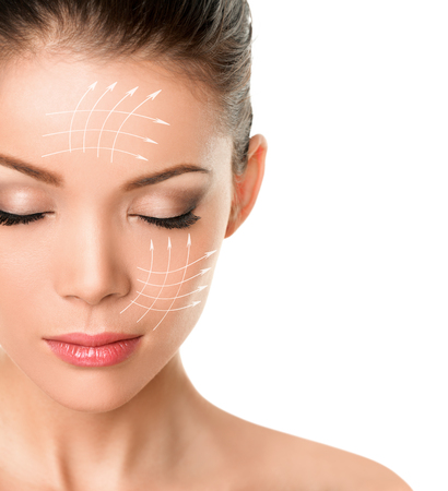 Face lift anti-aging facial treatment skin care product lifing sagging skin removing wrinkles for beauty woman. Arrow lines drawing on face.