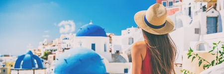 Santorini vacation honeymoon girl enjoying view of 3 blue domes famous tourist attraction in Europe. Banner panorama. Фото со стока