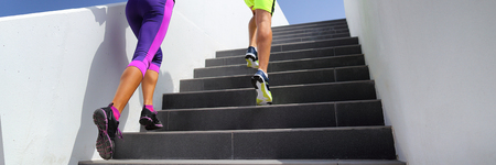 Stairs runners running fitness lifestyle banner. Jogging up staircase training hiit workout. Couple working out legs and cardio. Healthy active sport people exercising in urban city. Banque d'images