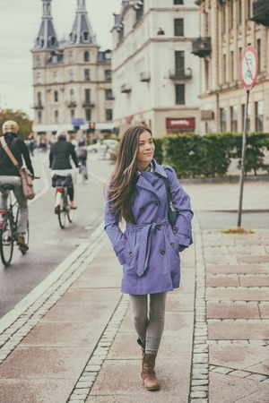 Autumn city lifestyle young woman walking relaxing outdoor in european street, urban living, Copenhagen, Denmark.
