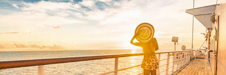 Cruise summer vacation woman watching sunset on deck banner panorama - Caribbean tropical landscape travel lifestyle. Reklamní fotografie