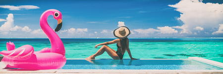 Vacation swimming pool banner luxury travel background woman relaxing by infinity overwater bungalow with pink flamingo float fun holiday concept panorama. Stok Fotoğraf - 124309373