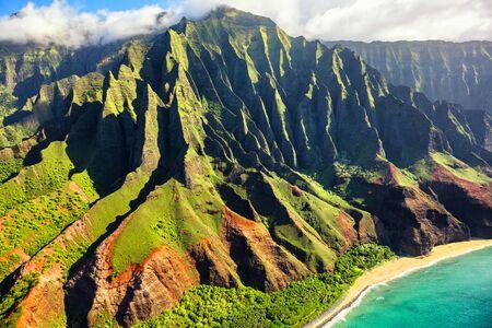 Hawaii nature travel destination. Na Pali coast on Kauai island. Helicopter aerial view of Na Pali Coast mountain landscape in Kauai island, Hawaii, USA. Фото со стока