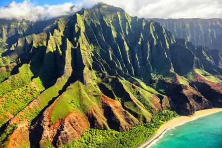 Hawaii nature travel destination. Na Pali coast on Kauai island. Helicopter aerial view of Na Pali Coast mountain landscape in Kauai island, Hawaii, USA. 版權商用圖片