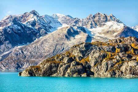 Alaska cruise travel. Glacier Bay National Park, Alaska, USA. Nature landscape of alaska mountain peaks and turquoise glacier water.