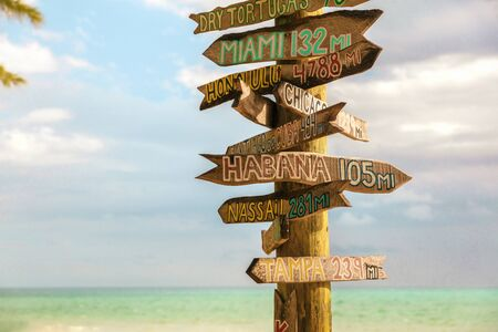 Key West Zachary Beach Tourist travel sign post, Florida summer vacation background, USA.