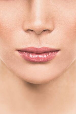 Lips beauty woman closeup of plum healthy mouth for lip injection fillers. Lipstick, lip gloss, makeup concept.