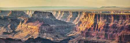Grand Canyon banner nature landscape steep cliffs at sunset dusk panoramic background