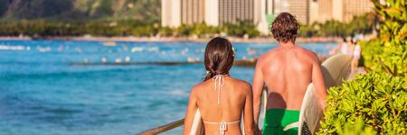 Hawaii surfers people Waikiki beach tourists lifestyle -summer travel vacation banner panorama.