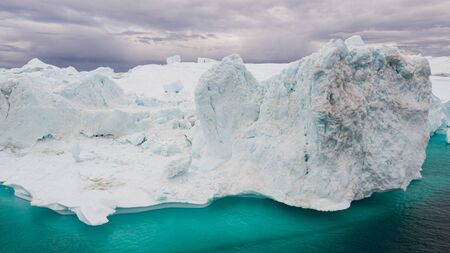 Arctic icebergs in Greenland, drone view. Global warming concept.