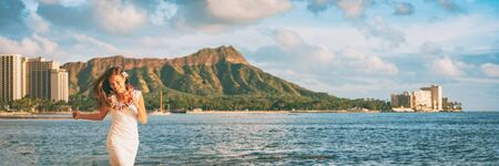 Hawaii Waikiki beach tourist woman happy in Honolulu travel banner vacation. Panoramic landscape with Diamond Head mountain in the background.