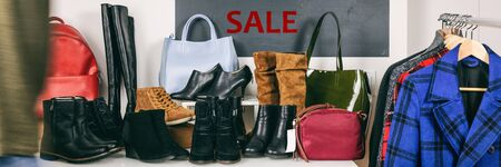 Shopping black friday sale at shoe store banner panorama. Winter boots shop. Sale sign in background with bags, warm coats and leather booties for women. Header background with blackboard sign.