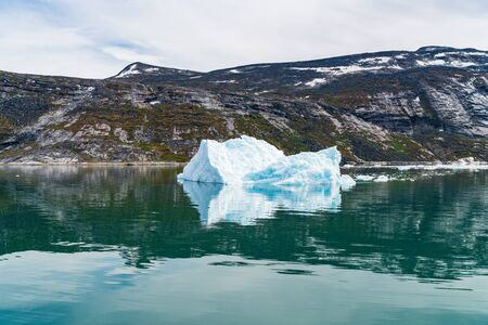 Photo of Iceberg and ice from glacier in arctic nature landscape on Greenland. Icebergs in Ilulissat icefjord. Affected by climate change and global warming. Stock fotó