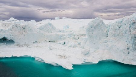 Greenland Iceberg landscape of Ilulissat icefjord with giant icebergs. Icebergs from melting glacier. Arctic nature. Stock Photo