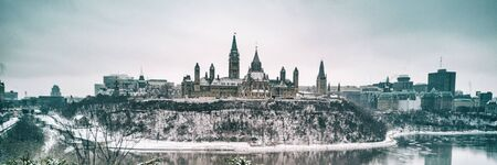 Ottawa Parliament in Winter . Cityscape of Canadas capital city, canadian travel destination in snow landscape. Banner panorama.