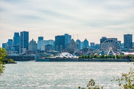 Montreal skyline city background travel tourist summer vacation cityscape, Quebec, Canada. View of Old Port against skyscrapers and Mount Royal mountain.