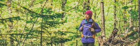 Autumn hike walking woman hiking in forest panoramic banner background. 版權商用圖片