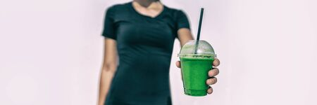 Green juice drink cafe waitress woman giving to go disposable cup with plastic straw healthy diet smoothie take-out breakfast food panoramic banner.