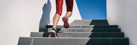 Cardio runner woman going up step of stairs at outdoor staircase for uphill hiit workout training exercise. Banner panoramic running shoes closeup.