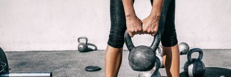 Kettlebell weightlifting woman lifting free weight panoramic banner gym. Hands holding heavy kettle bell for strength training exercise lifestyle. Banco de Imagens