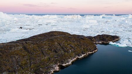 Greenland. Arctic nature landscape with icebergs in Greenland icefjord. Aerial drone footage image of ice and iceberg. Ilulissat Icefjord with icebergs from Jakobshavn Glacier, Sermeq Kujalleq glacier