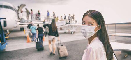 Airport Asian woman tourist boarding plane taking a flight  wearing face mask. Coronavirus flu virus travel concept banner panorama. Archivio Fotografico