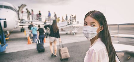 Airport Asian woman tourist boarding plane taking a flight wearing face mask. Coronavirus flu virus travel concept banner panorama.