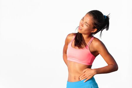 Stomach pain ache Asian woman upset with painful side stitch cramp during exercise workout isolated on white background. Runner cramps running athlete jogging with stomach side pain after workout.