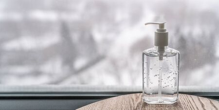 Coronavirus hand sanitizer gel to wash hands for flu virus prevention. Alcohol based antimicrobial disinfectant product for airport, hospital, healthcare and home panoramic banner background. Stok Fotoğraf