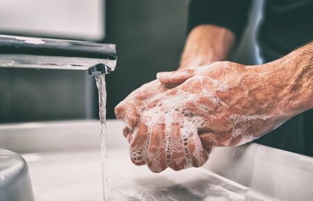 Virus prevention awareness to wash hands with soap warm water and , rubbing nails and fingers washing frequently or using hand sanitizer gel. 免版税图像