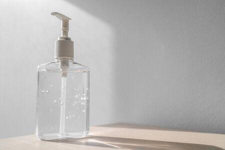 Coronavirus hand sanitizer bottle dispensing rubbing alcohol gel for hands hygiene health care prevention. Corona virus outbreak pandemic sanitiser background.