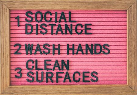 Coronavirus COVID-19 Prevention sign for social distance, hand hygiene, sanitisation of surface. Self isolation and stayin home social distancing, washing hands frequently, cleaning surfaces. Stock Photo