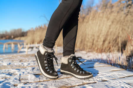 Snow boots fashion footwear for winter season girl wearing black leather ankle shoes. 版權商用圖片