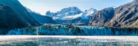 Glacier Bay Alaska banner view from cruise at Johns Hopkins Glacier summer travel in Alaska, USA. Banner panorama crop. Stock Photo
