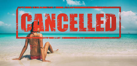 Beach travel vacation for winter holidays cancelled due to coronavirus. South getaway woman in bikini tanning on Caribbean sand. Happy Christmas Santa girl on winter south holidays cruise vacation.
