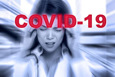 Hospital crisis stressed Asian doctor in burnout with overflowing patients from coronavirus disease at intensive care. Stress, anxiety of healthcare workers during pandemic Stock Photo