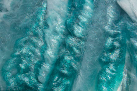 Original color epoxy resin texture. Abstract art background. close up photo art for your design project. Painting can be used as a trendy background for wallpapers, posters, cards, websites.