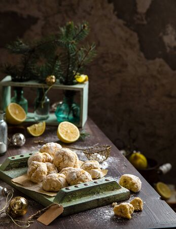 vintage wine glasses with champagne on old wooden green tray stands on rustic table christmas toys, fir tree branches. new year still life Foto de archivo - 133845747