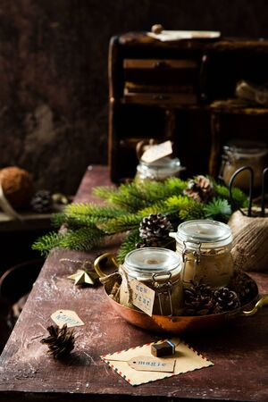 homemade liver pate in glass jars on rustic table with fir tree branches, toys. edible christmas present Foto de archivo - 133845817