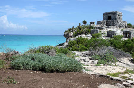 The temple of the wind on the Mayan site of Tulum in Mexico photo