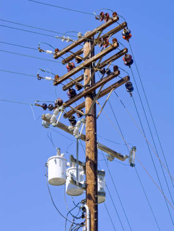 This is a photograph of above ground Power Lines. Stock Photo