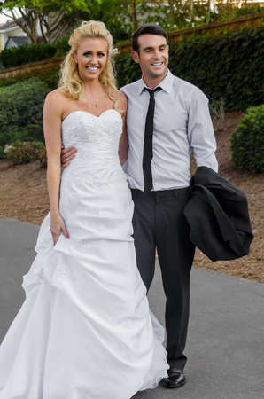 Beautiful young bride and groom in the park ready for their\ wedding ceremony