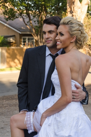 Beautiful young bride and groom in the park ready for their wedding ceremony  photo