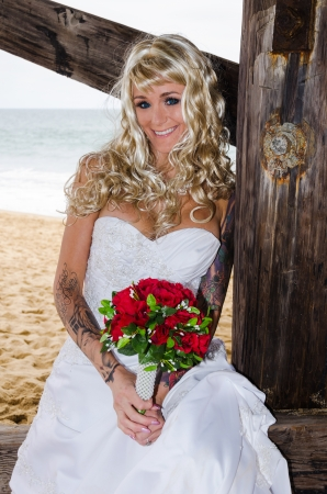 Beautiful bride at the beach on the sand photo