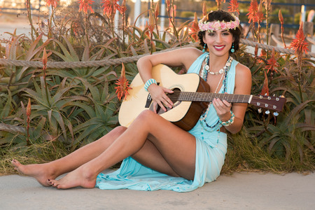 woman guitar: Beautiful young lady at the beach playing music with her guitar. Doheny State Beach, California, USA Stock Photo