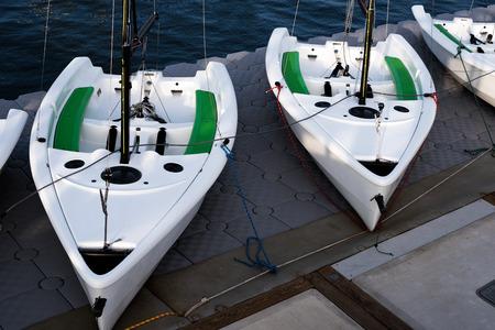 Sail boats docked in the Newport Beach Marina. Stock Photo